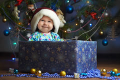 Joyful little baby in the present box stock photography