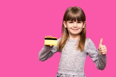 Free Joyful Little Blonde Shy Face Girl 6-7 Years Old Hold Credit Bank Card With Thumb Up Isolated On Pink. Childhood Lifestyle Concept Stock Images - 180072124