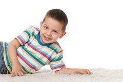 Joyful little boy on the carpet Royalty Free Stock Images
