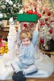 Joyful little boy with Christmas present. Stock Photo