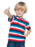 Joyful little boy holding his thumb up Stock Images