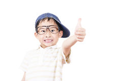 Joyful little boy holding his thumb up Stock Image