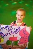 Joyful little boy`s birthday party, children`s happiness.  Royalty Free Stock Photography