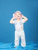 Joyful little boy in a sailor suit Royalty Free Stock Image