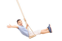 Joyful little boy swinging on a swing Stock Photography