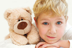 Joyful little boy with teddy bear is happy and smiling. Close-Up Stock Photo