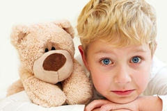 Joyful little boy with teddy bear is happy and smiling. Close-Up Royalty Free Stock Photo