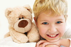 Joyful little boy with teddy bear is happy and smiling. Close-Up Stock Photos