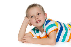 Joyful little boy on the white. A cheerful little boy in striped shirt on the white background Stock Photo