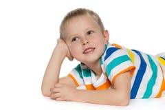 Joyful little boy on the white Stock Photo