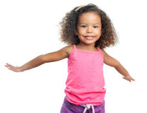 Joyful little girl with an afro hairstyle laughing with her arms extended Stock Photos