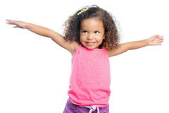 Joyful little girl with an afro hairstyle laughing with her arms extended Royalty Free Stock Images