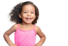 Joyful little girl with an afro hairstyle smiling. Isolated on white Stock Image