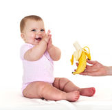 Joyful little girl with banana. Royalty Free Stock Images