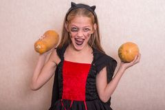 Joyful little girl in a costume for Halloween Stock Photography