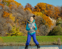 joyful little girl dancing in autumn park on sunny beautiful gorgeous day Royalty Free Stock Photo