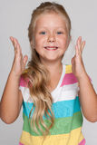 Joyful little girl on the gray background Royalty Free Stock Photography