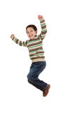 Joyful little girl jumping. On a over white background Stock Photo