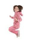 Joyful little girl jumping Royalty Free Stock Photos