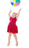Joyful little girl jumps high for an inflatable Stock Image