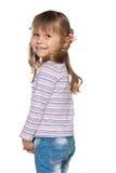 Joyful little girl looks back Stock Photos