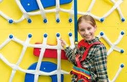 Joyful little girl near climbing wall Royalty Free Stock Photo