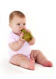 Joyful little girl with pear. Stock Photos
