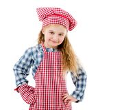 Joyful little girl in red apron isolated on white background. Joyful little girl in red plaid apron, chef hat and baking glove smiles isolated on white Stock Images