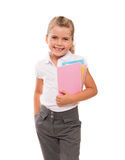 Joyful little girl standing on white with few colorful notebooks Royalty Free Stock Photo