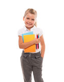 Joyful little girl standing on white with few colorful notebooks. I'm ready for the lessons Stock Photography