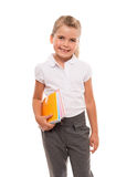 Joyful little girl standing on white with few colorful notebooks Stock Photo