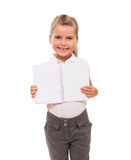 Joyful little girl standing on white with open notebook. Look, what we studied today Stock Photography