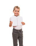 Joyful little girl standing on white with open notebook Royalty Free Stock Images