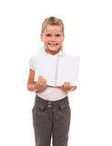 Joyful little girl standing on white with open notebook Stock Photo