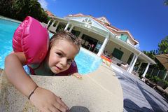 Joyful little girl in the swimming pool Royalty Free Stock Photo