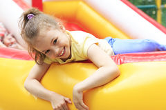 Joyful little girl on a trampoline. Royalty Free Stock Photography