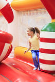 Joyful little girl on a trampoline. Royalty Free Stock Photos