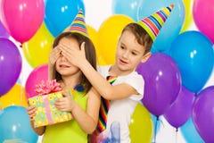 Joyful little kid girl receiving gifts at birthday stock photo