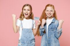 Free Joyful Little Kids Girls 12-13 Years Old In White T-shirt Denim Clothes Isolated On Pastel Pink Background. Childhood Royalty Free Stock Photography - 192640017
