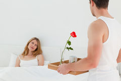 Joyful lovers having breakfast in their bed Royalty Free Stock Photo