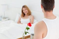 Joyful lovers having breakfast in their bed Royalty Free Stock Image
