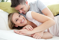 Joyful lovers having fun together on a sofa Stock Image