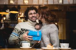 Joyful loving couple celebrating valentine day in cafe royalty free stock images