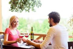 Joyful loving couple having date in restaurant royalty free stock images