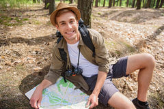 Joyful male adventurer searching for location Royalty Free Stock Images