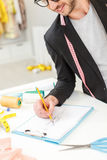 Joyful male designer drawing sketch in atelier Stock Photos