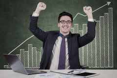 Joyful male entrepreneur with business graph Royalty Free Stock Images