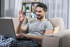 Joyful male having video chat by internet stock images