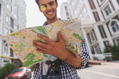 Joyful male tourist planning his journey Royalty Free Stock Image