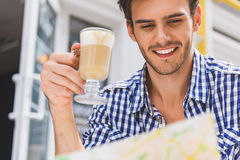Joyful male tourist preparing for travel Royalty Free Stock Photography